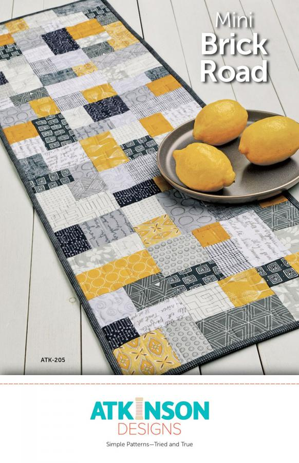Mini Brick Road table runner, doll/mini quilt, and place mats sewing pattern from Atkinson Designs