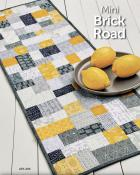 Mini Brick Road table runner, doll/mini quilt, and place mats sewing pattern from Atkinson Designs 2