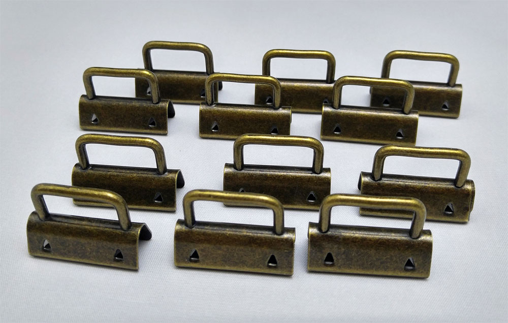 Strap-Ends-12-Pack-AntiqueBrass-Sew-TracyLee-Desgins